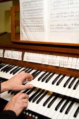 organ keyboard and sheet music