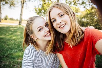 Two happy teenage girls taking a selfie