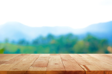 Wood table top on blur mountain background