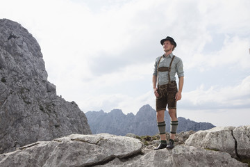 Germany, Bavaria, Osterfelderkopf, man in traditional clothes standing in mountain landscape