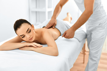 Spa Woman. Massage Procedure In Beauty Spa Salon. Body Care.