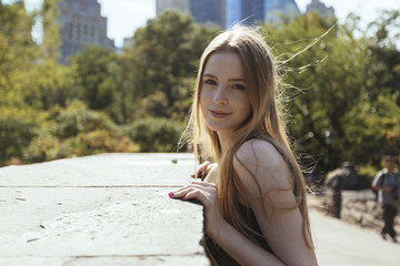 USA, New York City, portrait of young woman in Central Park