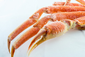 frozen crab claw in a box for sale on the market