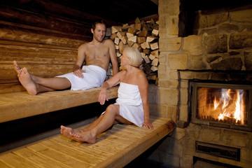 Germany, senior woman and man sitting in sauna