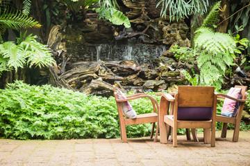 Outdoor wooden chair in the garden