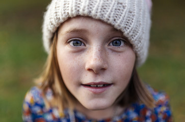Portrait of smiling girl wearing woollen cap