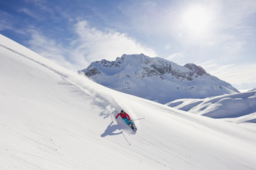 Austria, Zurs, Lech, Young woman doing alpine skiing on Arlberg mountain