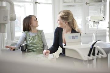 Germany, Bavaria, Landsberg, Mother and daughter (8 9) in dental surgery
