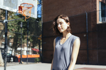 USA, New York City, Manhattan, young woman standing on a playground