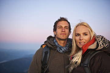 Couple smiling in mountains