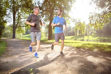 Two men jogging together in a park