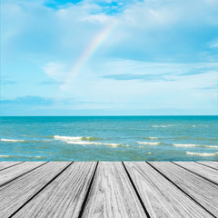 Wood Terrace on The Beach with Blue Sea and Sky with Rainbow after Raining