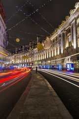Regent Street Christmas lights and decorations at night, London UK