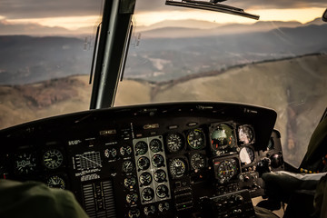 Flying in sunset over mountains in cockpit