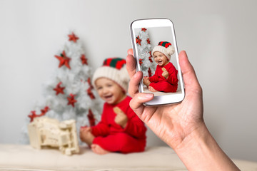 Smartphone screen showing smiling boy