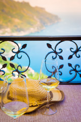 Ravello, Romantic Scene: two glasses of white wine in front of the Amalfi Coast, table for two