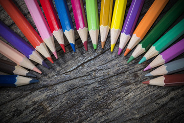 Colorful pencil on wood background
