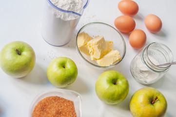Apple pie ingredients on white