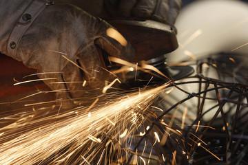 Germany, Upper Bavaria, Munich, Schaeftlarn, Sculptor abrasive cutting at work