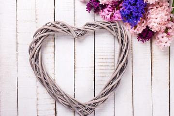 Postcard with big decorative heart and fresh hyacinths