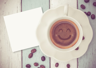 Smile coffee cup and paper note on table