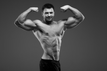 Bodybuilder posing in the studio