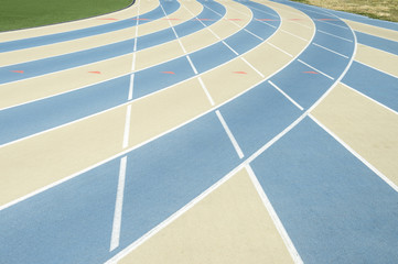 Modern running track background in blue and tan full frame close-up abstract sports background