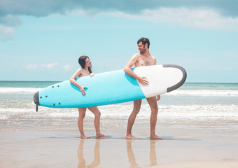Surfers at the beach - Stock image
