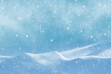 Christmas background with snowdrifts and the falling snow