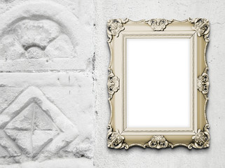 Close-up of one baroque picture frame on medieval stone wall background