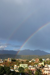 Double rainbow in the sky after rain. Hetauda, Nepal
