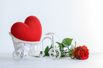 Red Heart in vintage bicycle basket and rose