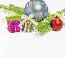 Several christmas decoration on green pine tree on white backgro