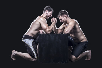 Two sportsmen armwrestling Wall mural