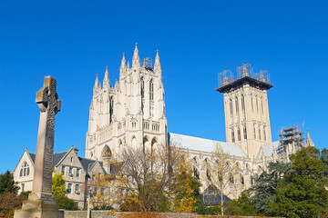 Washington National Cathedral grounds in US capital in autumn. National Cathedral in the late afternoon sun in late autumn.