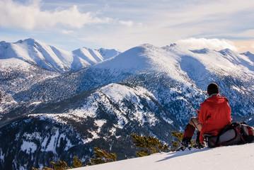 Man is resing in high snowy mountain. Rila, Bulgaria.