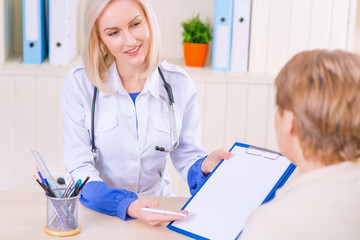 Pleasant nurse speaking with her patient