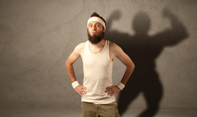 Skinny man with musculous shadow