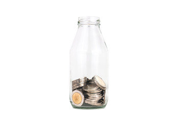 saving thailand coins in open bottle white background