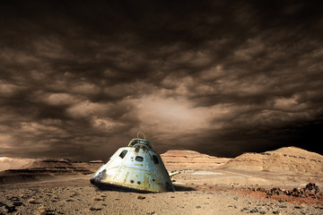A scorched space capsule lies abandoned on a barren world. - Elements of this image furnished by NASA