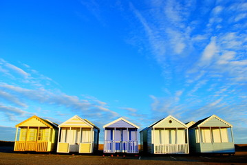 Beach huts against blue sky