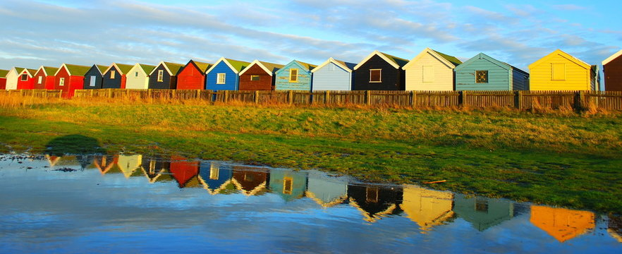 Very colourful beach huts in Southwold, Suffolk. Famous holiday destination in England.