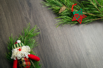 Christmas tree and Santa Claus on wooden background