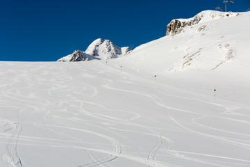Fresh ski tracks on ski slope