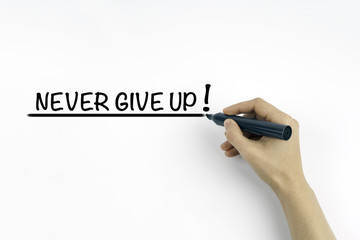 Hand with marker writing the text - Never give up!