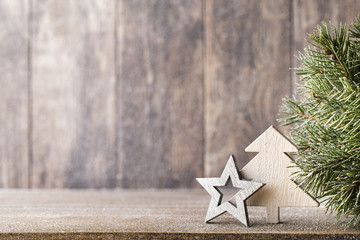 Christmas fir branch and decor, on the wooden background.