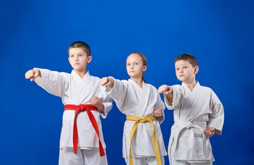 Three young athletes are beating punch hand