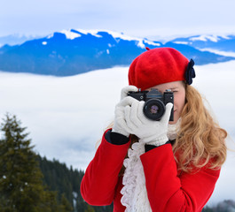 Christmas girl, holding photo camera