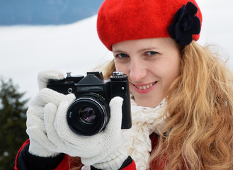 Woman with camera, outdoor