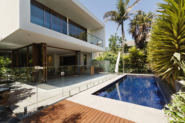 Rear garden of a contemporary Australian home with pool